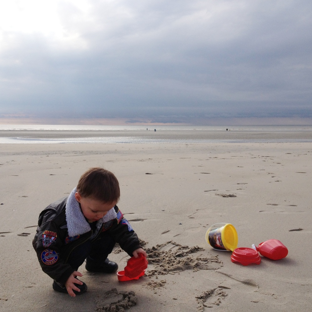 playing in the sand at Le Touquet