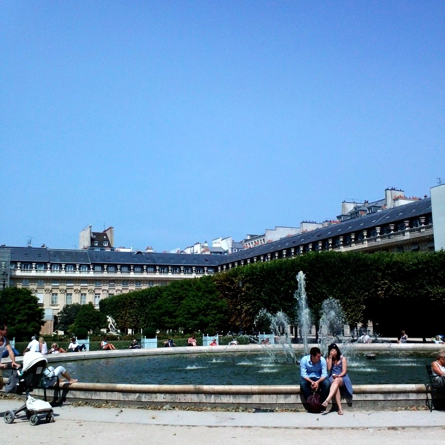 sunbathing around a fountain, palais royale