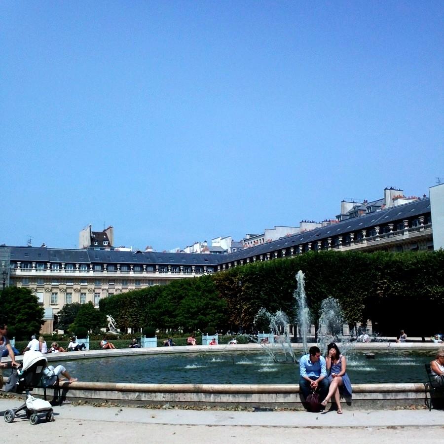 sunbathing around a fountain, palais royale