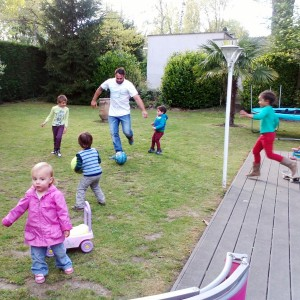 backyard soccer, pros and toddlers all together