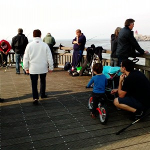 watching the fishermen on the pier at calais